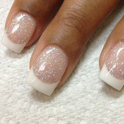 French blush glitter and white nails are a perfect idea to add a bit of sparkle to a winter bridal look