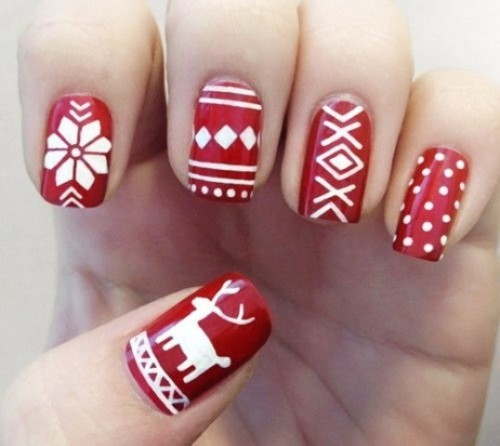 a red manicure with white patterns - Scandinavian winter ones for a cozy and cool winter look