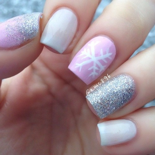 white nails, a pink nail with a snowflake, a silver glitter nail for a bright modern touch to your glam winter bridal look