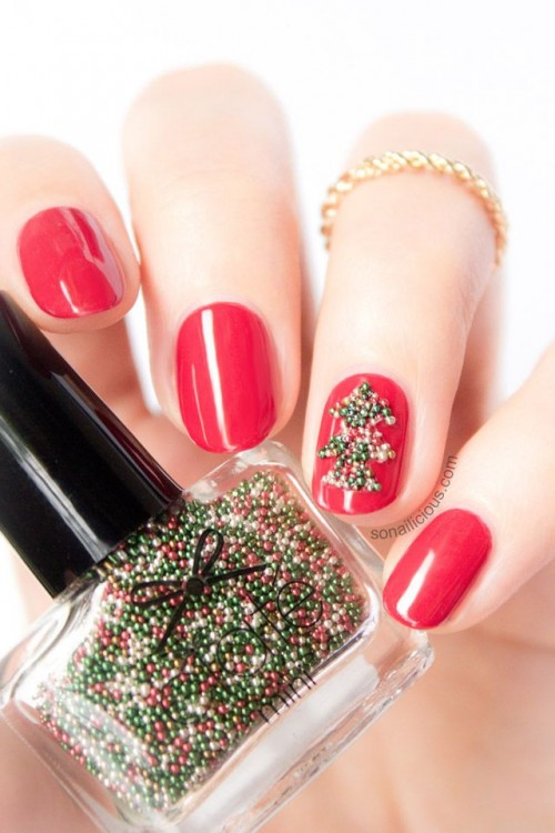 bold red nails with an accent nail that shows off a green bead tree are very creative, bold and stylish for a color-loving bride