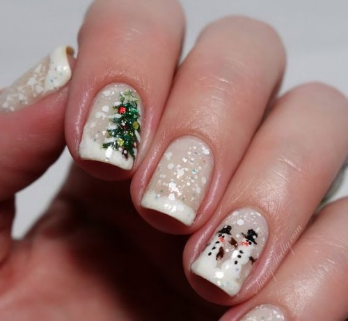 a French manicure with glitter, polka dots, trees and snowmen is a stylish and whimsical idea to rock