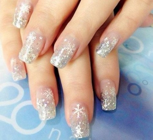 a silver glitter wedding manicure with snowflakes, stars and polka dots will help you shine all over