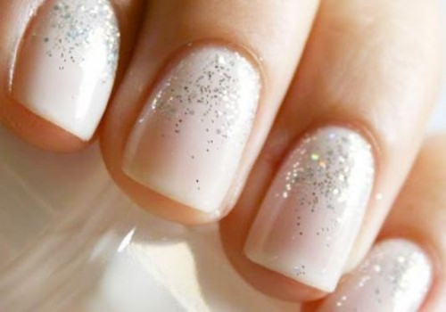 a blush wedding manicure with a bit of silver glitter on top is a stylish glam idea to rock