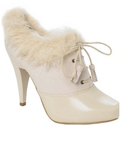 neutral faux fur booties with laces with tassels are chic and cool and won't let you feel cold