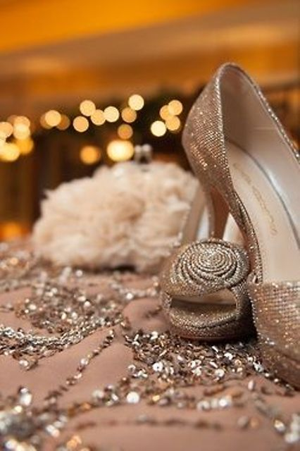 silver glitter heels with fabric flowers are an elegant vintage-inspired idea for a winter bride