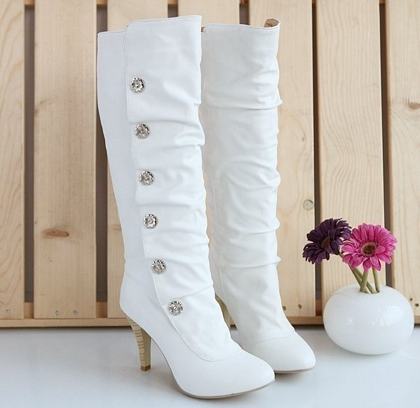 white tall boots with rhinestone buttons and heels will be a whimsy and cool option for a winter bride