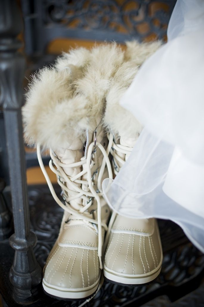 tall fur boots with laces are amazing for a snowy wedding, just change them for usual shoes inside