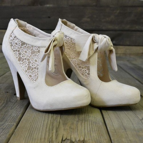 neutral cutout booties with lace inserts and ties are great for vintage-inspired winter brides