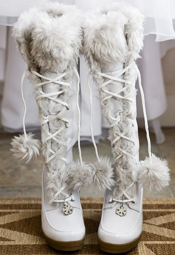 white fur knee boots with lace and fur pompoms are great for a cold or snowy wedding and can be worn at a mountain wedding, too