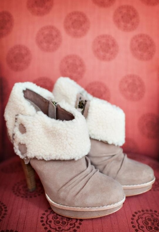 taupe heeled booties with white fur and buttons for a cozy feel and a stylish look at a winter wedding