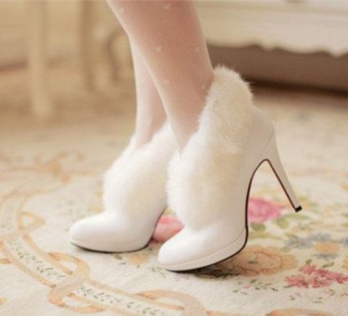 white heeled fur booties are a chic and cute shoe idea for a winter bride, you'll feel a snowy queen
