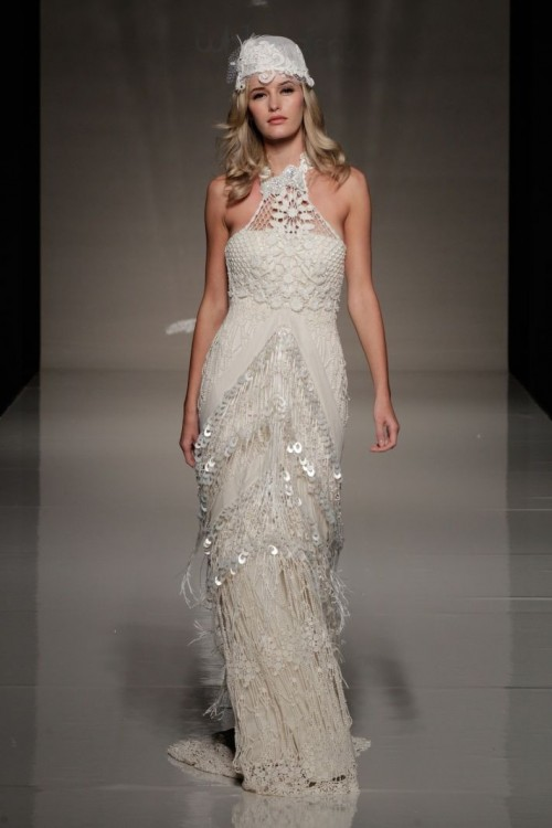 a boho lace embellished fitting wedding dress with a halter neckline and matching headpiece