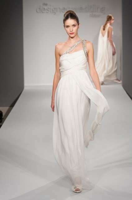a unique draped sheath wedding dress with embellished belts on one shoulder reminds of Grecian gowns