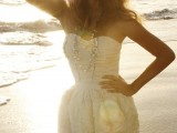 a strapless short wedding dress with a draped bodice and fabric flower skirt plus layered necklaces for a glam girl