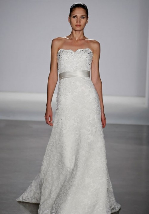 a strapless lace embellished wedding dress with a silver silk sash is a very romantic and chic idea
