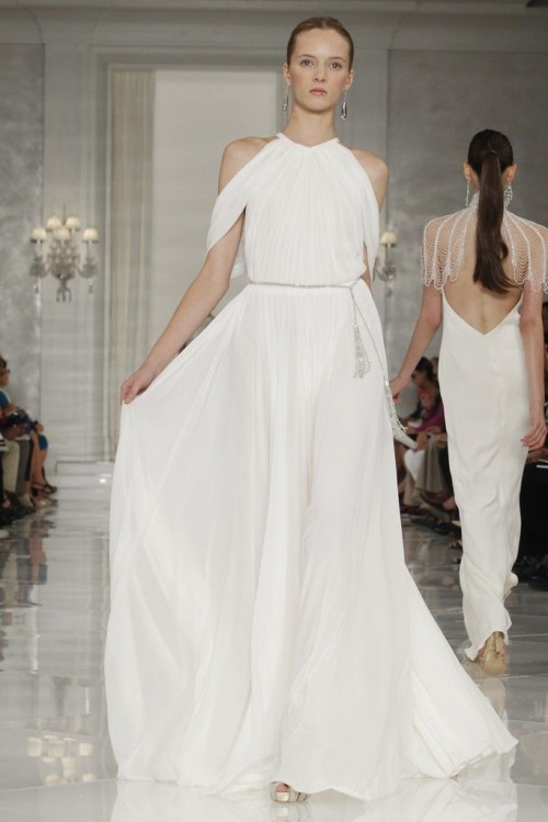 a flowy and airy halter neckline wedding dress with draperies and a silver sash with tassels for a minimalist bride