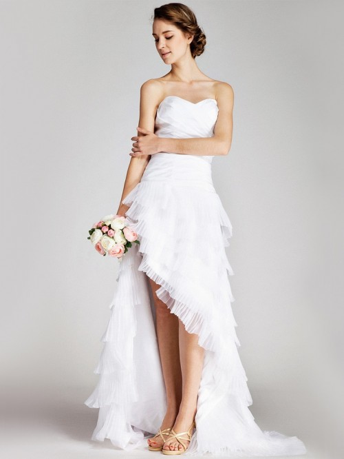 a strapless high low wedding dress with an asymmetrical ruffle skirt with a train for a romantic bride