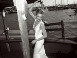 a modern silk sheath wedding dress with a deep neckline, wide straps and a train for a modenr or minimalist bride
