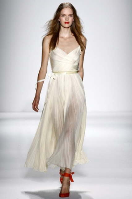 a modern midi wedding dress with a draped bodice and an airy skirt, red ankle strap shoes
