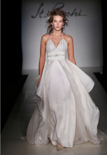 an A-line wedding dress with an embellished bodice, an airy asymmetrical skirt and sheer heels