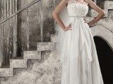 a whimsy one shoulder wedding dress with an applique bodice, an asymmetrical skirt and a train