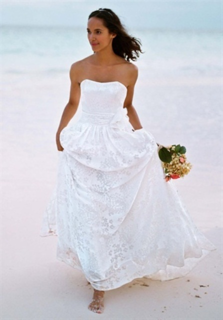a vintage strapless wedding dress with a lace skirt is a timeless option that looks elegant and refined