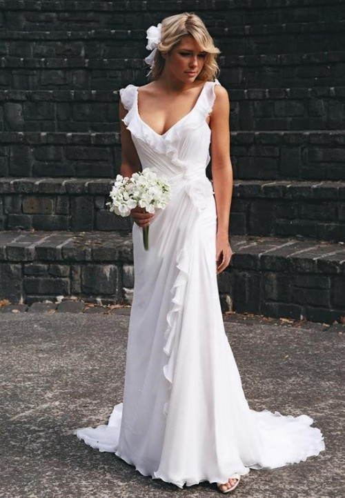 a simple and beautiful draped sheath wedding dress with ruffles and a depe neckline and sandals for a comfy and casual look