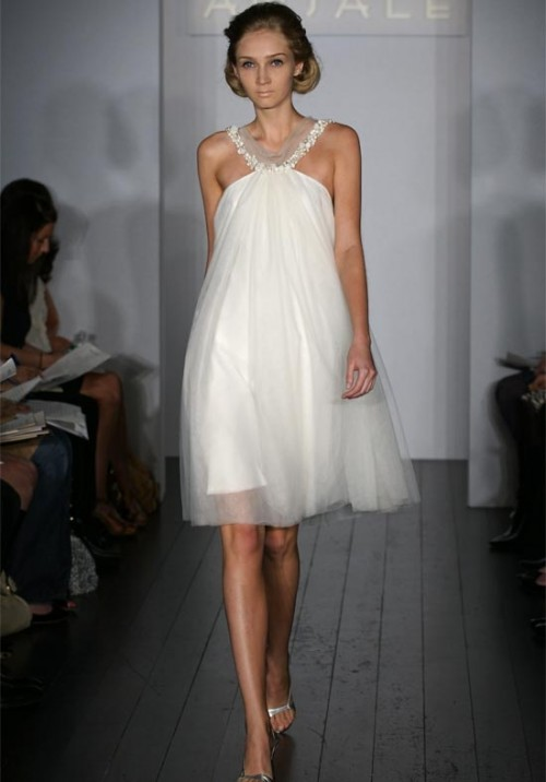 a modern A-line short wedding dress with an embellished neckline and silver shoes for a sexy and glam bridal look