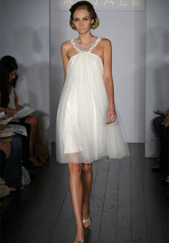 a modern A line short wedding dress with an embellished neckline and silver shoes for a sexy and glam bridal look