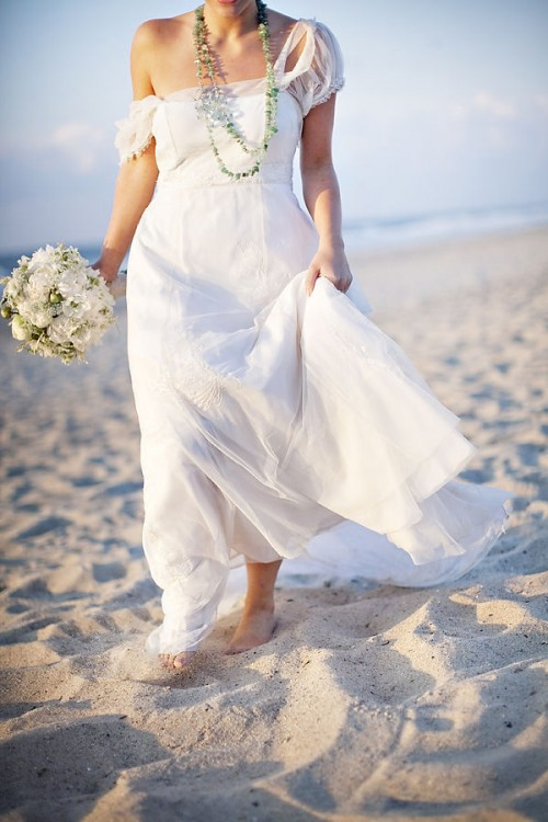a romantic plain off the shoulder wedding dress with layered necklaces is a chic and beautiful idea