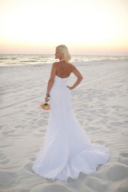 a strapless mermaid wedding gown with a statement necklace is a timeless idea for a beach bride