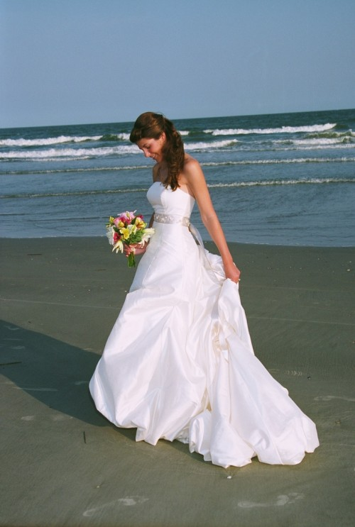 a strapless A-line wedding dress with a silver sash and a train is a refined and chic idea