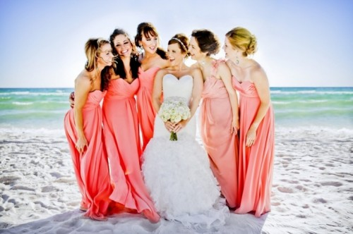 refined coral and pink maxi strapless dresses with draped bodices will make your bridesmaids look royal-like