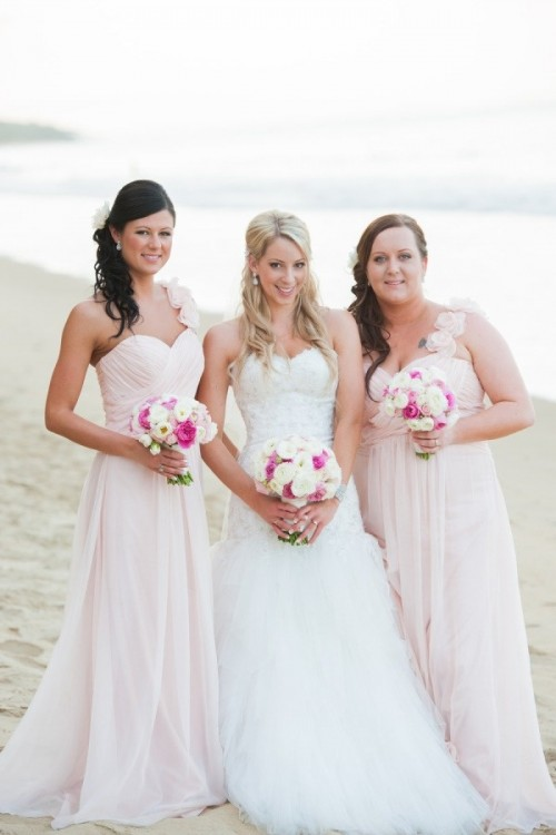blush strapless sweetheart neckline maxi dresses with draped bodices and floral straps on one shoulder