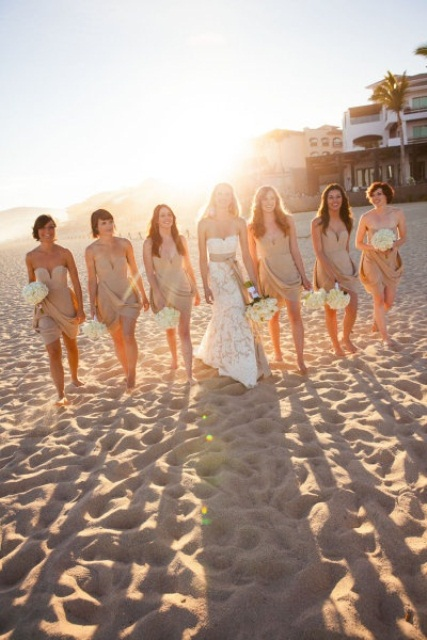 matching nude strapless mini dresses with draperies will make your bridesmaids look very chic
