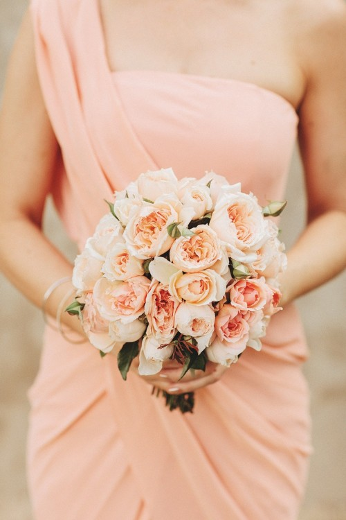 a draped peachy pink bridesmaid dress with a strap on one shoulder is very lovely and chic