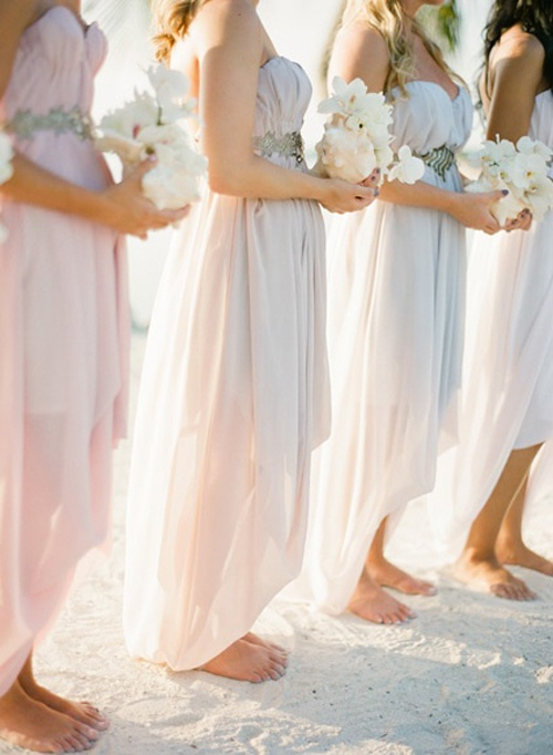 matching strapless blush and off white draped asymmetrical bridesmaid dresses for a chic and stylish beach wedding