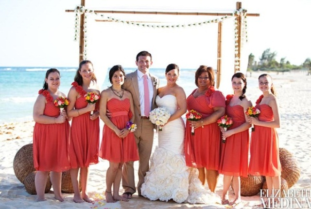 coral knee dresses with a strap on one shoulder are lovely and bright and can be worn to a bold beach wedding