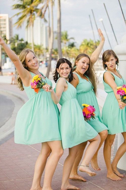 turquoise A-line bridesmaid knee dresses with thick straps and V-necklines for a bright beach wedding