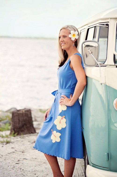 an electric blue midi bridesmaid dress with a florla pattern and thick straps is a bold and stylish idea