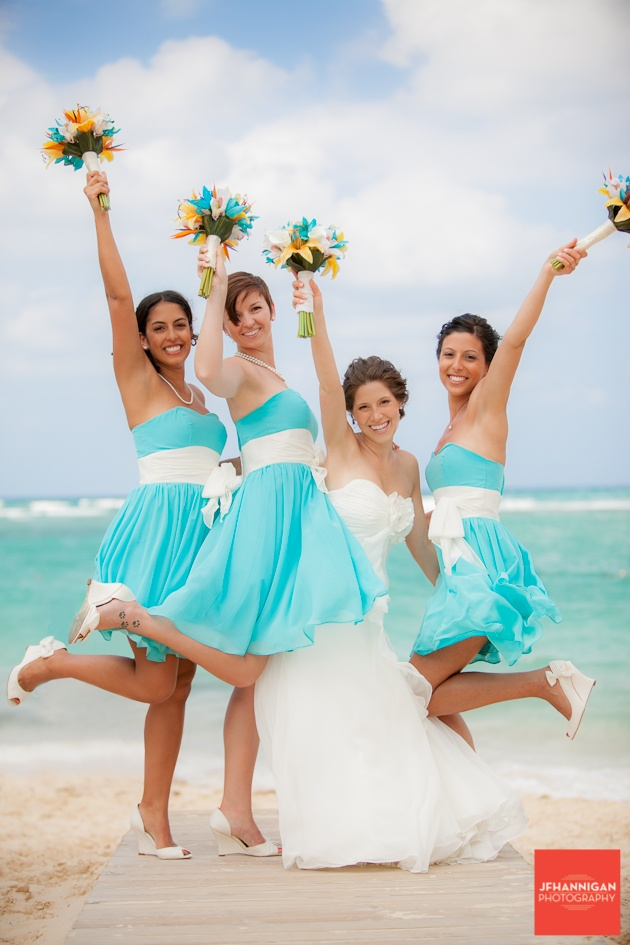 bright turquoise A line bridesmaid dresses with white sashes and white shoes for a bold beach wedding