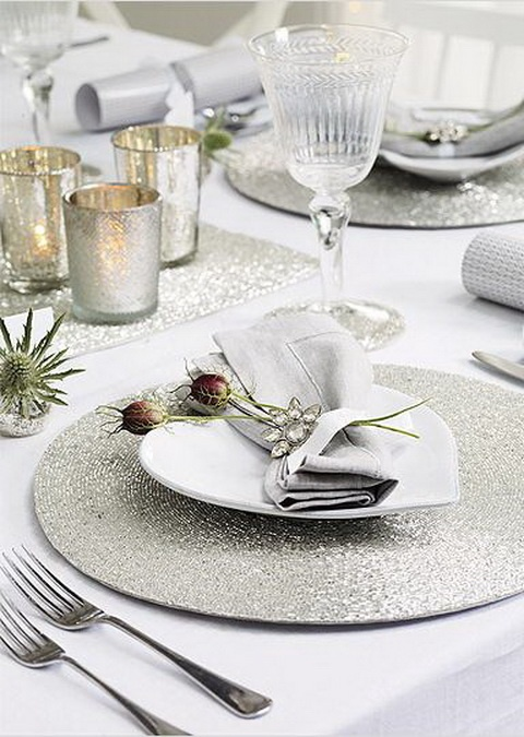 a neutral and shiny palce setting with glitter placemats and runners, thistles, dried blooms and mercury glass candleholders