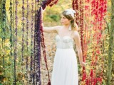 an ombre colorful fringe fall wedding backdrop is done in bold shades to embrace the season and can be easily DIYed