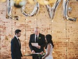 hanging lights and a silver letter balloon backdrop is a pretty solution for many types of weddings and all the seasons