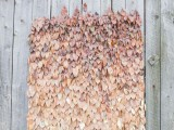 a bold ombre fall leaf wedding backdrop is a beautiful way to embrace the season and can be DIYed if you are ready to spray paint a lot of leaves