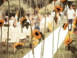 a backdrop of hanging crystals and sunflowers is a lovely idea for the fall and it will easily match a rustic or a farmhouse wedding