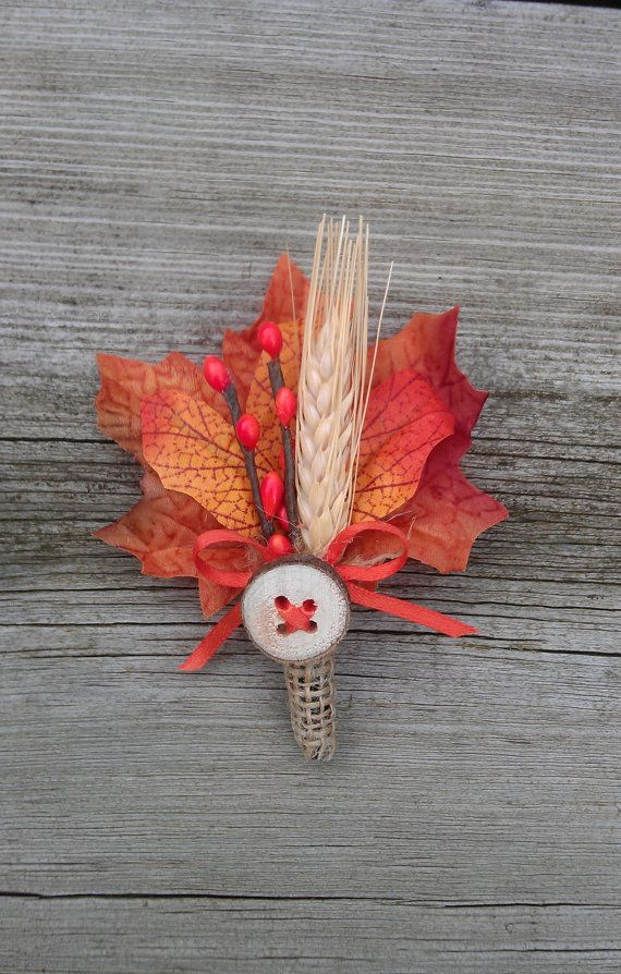 a bright fall wedding boutonniere with bold leaves, faux berries, a spike and a button plus some twine