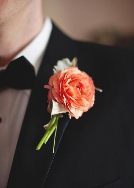 a bright orange and pale leaf wedding boutonniere for a refined and elegant fall groom's look