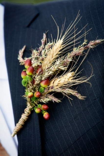 a lovely rustic wedding boutonniere with spikes, lavender and berries plus a twine wrap is a stylish idea