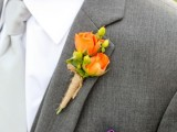 a small and bright wedding boutonniere with orange blooms and berries and twine wrap is a stylish and pretty idea
